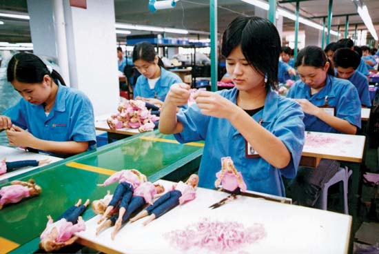 China Workers make dolls at a toy factory